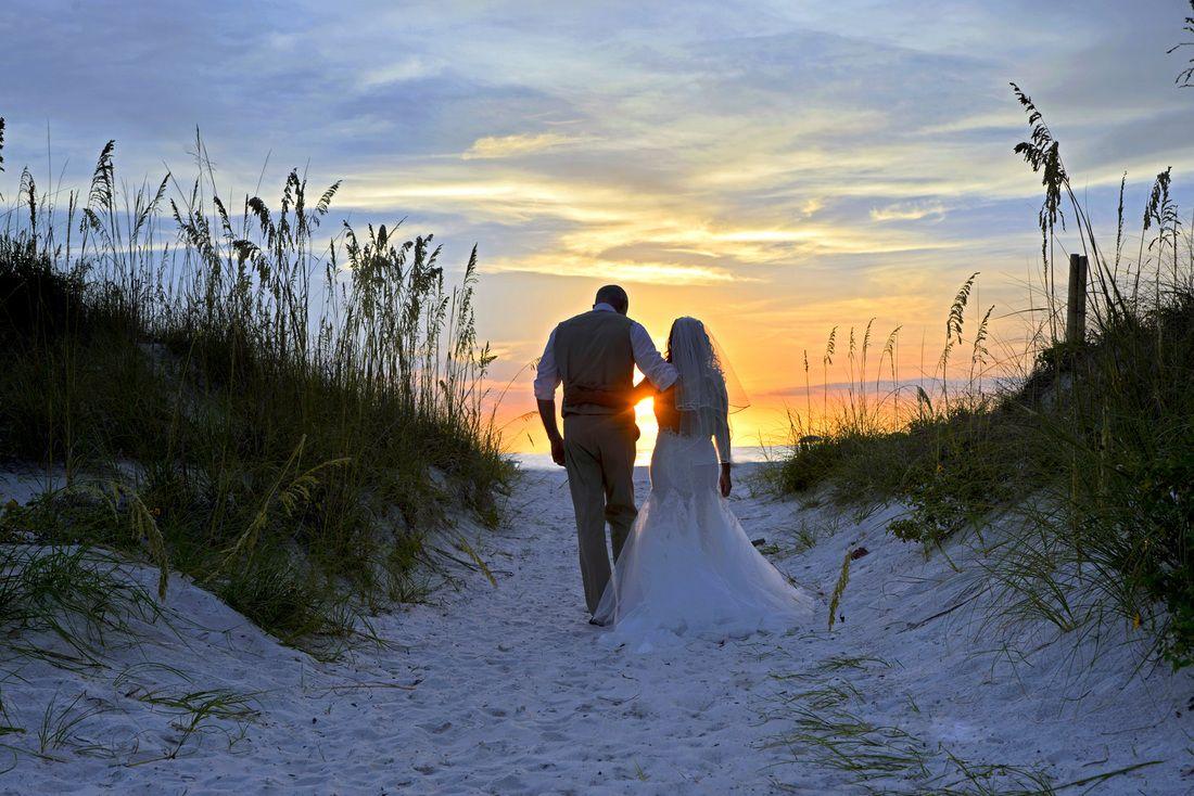 Sunrise beach wedding  A beach wedding specialist and wedding planner arranging beautiful