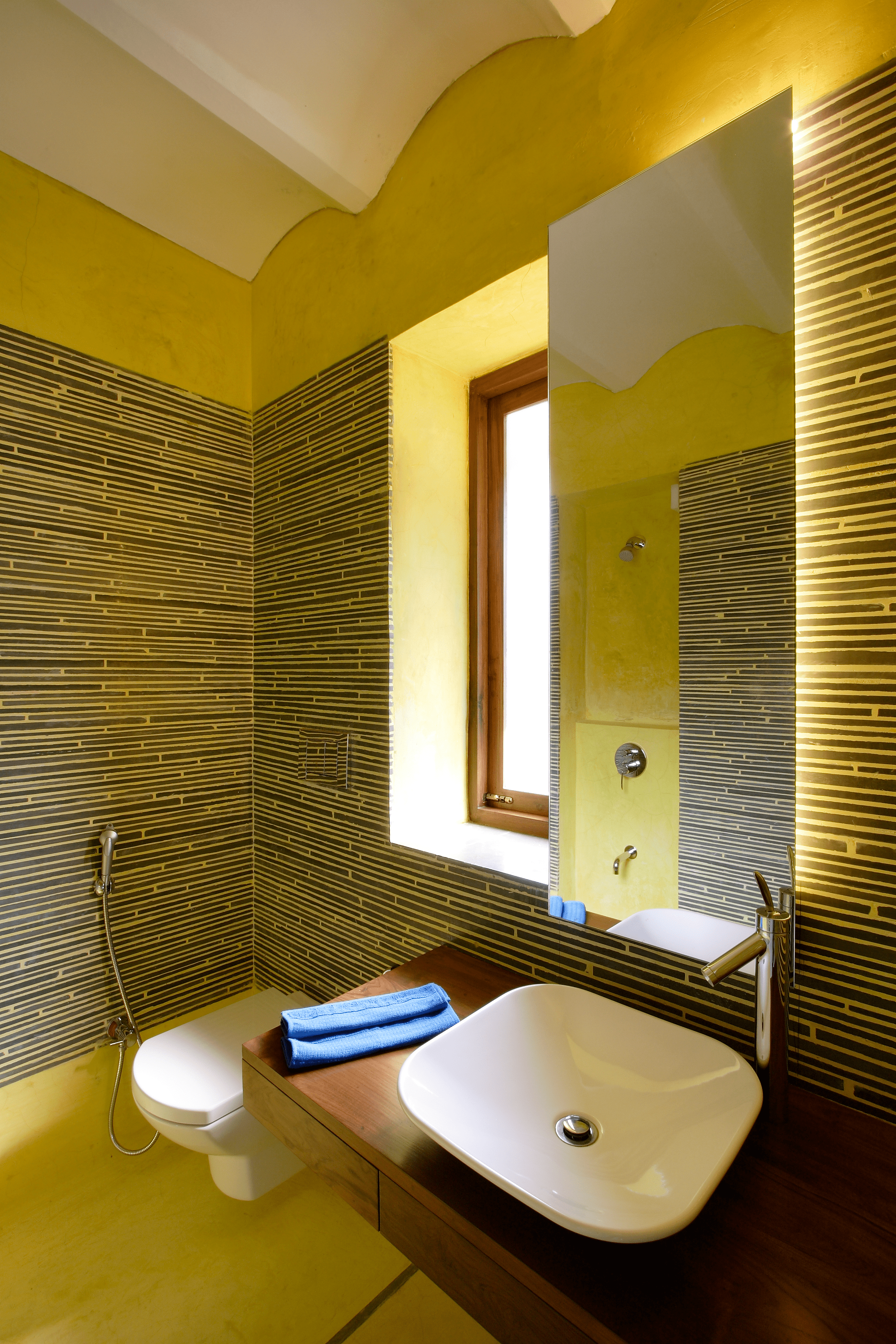Maximizing style with minimal space kota stone from after laying the floor was used as the finishing material in the washroom DhrutiVaidya
