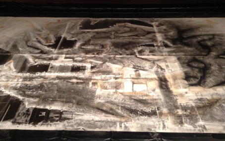 As part of Silver and Water, currently on view in the museum's South and Brackett Clark galleries, an 8-foot by 12-foot negative of Kodak's chemical factory was soaked in a shallow bath of water, the silver image slowly decaying.