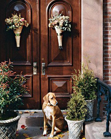 Cornucopia Door Arrangement:   These exuberant door decorations are inspired by that well-known symbol of harvest abundance, the cornucopia.
