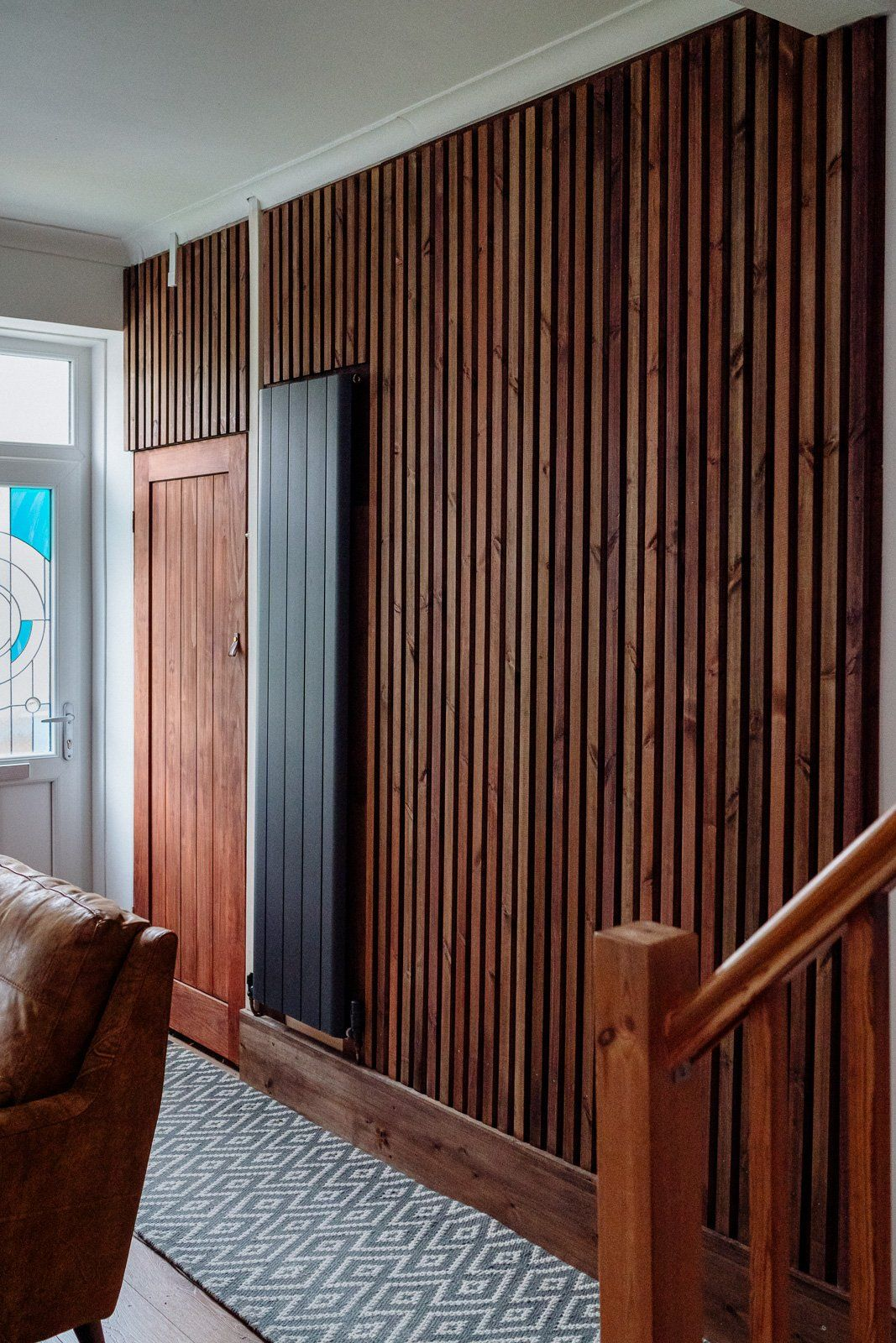 Building a diy vertical wooden slat wall our crafty home