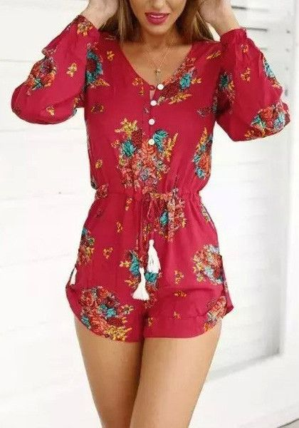 This red floral button-down romper features red floral print design all around the fabric with long sleeves, V neckline with front button detailing and an adjustable drawstring at waist. | Lookbook Store What's New