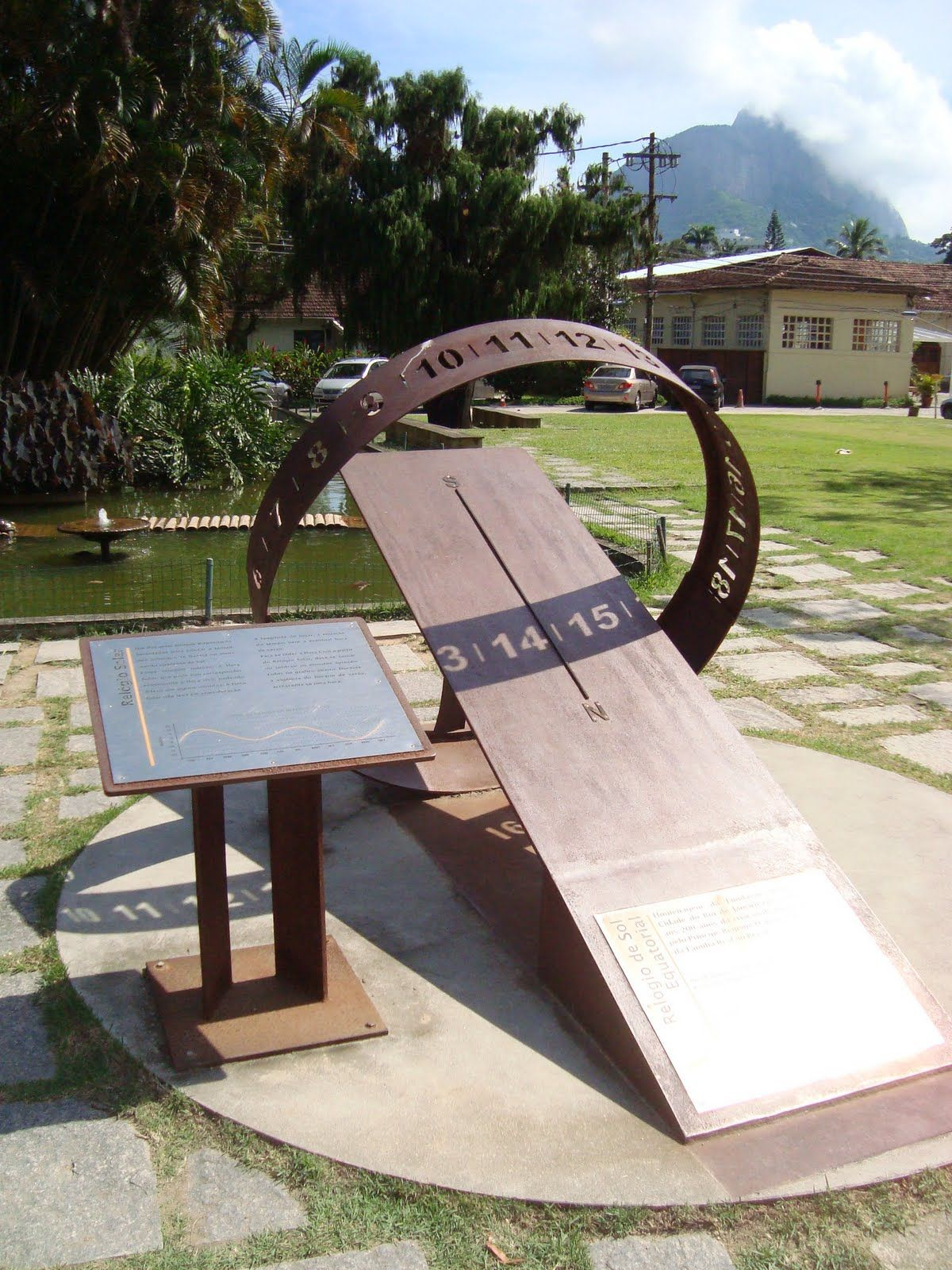 Idea for garden sculpture? Sun clock sundial - maybe replace center with sculpture to reflect time? wonder how to make? How space curved numbers on curved metal? Maybe Make curved cardboard template ?