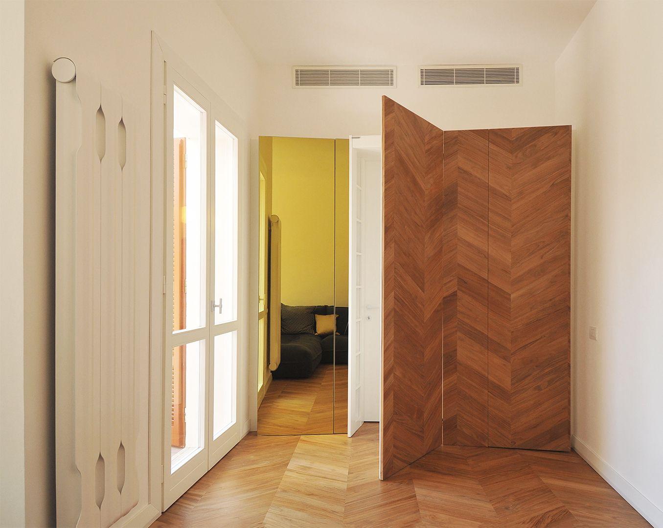 #tissellistudio secret white doors behind wooden closets