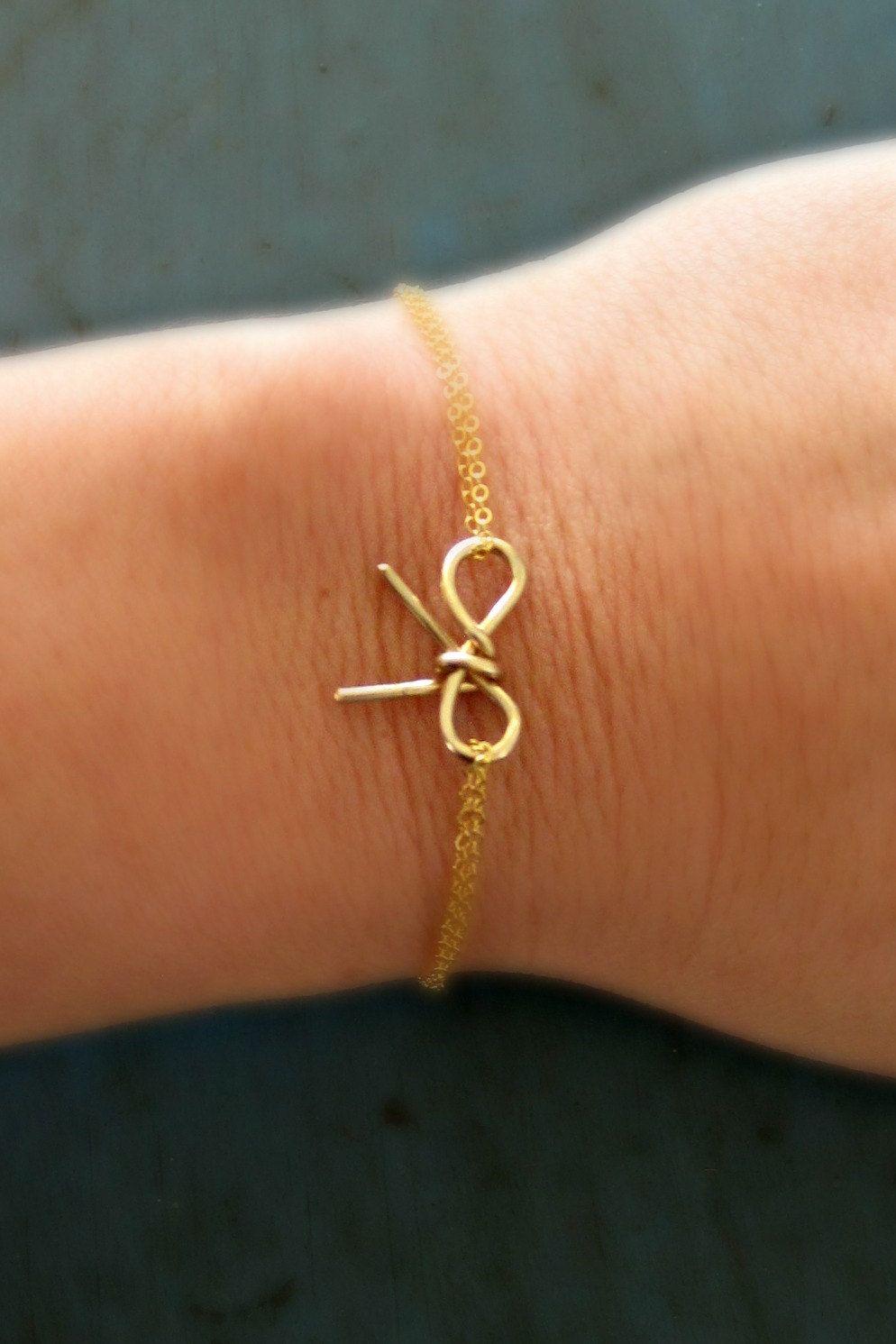 Gold Bow Bracelet Simple Minimalist Jewelry bridesmaid gifts. $19.50, via Etsy.