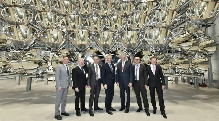 German scientists have assembled an artificial sun , composed of the largest collection of high-powered spotlights in the world, and are about to turn it on in the name of science .