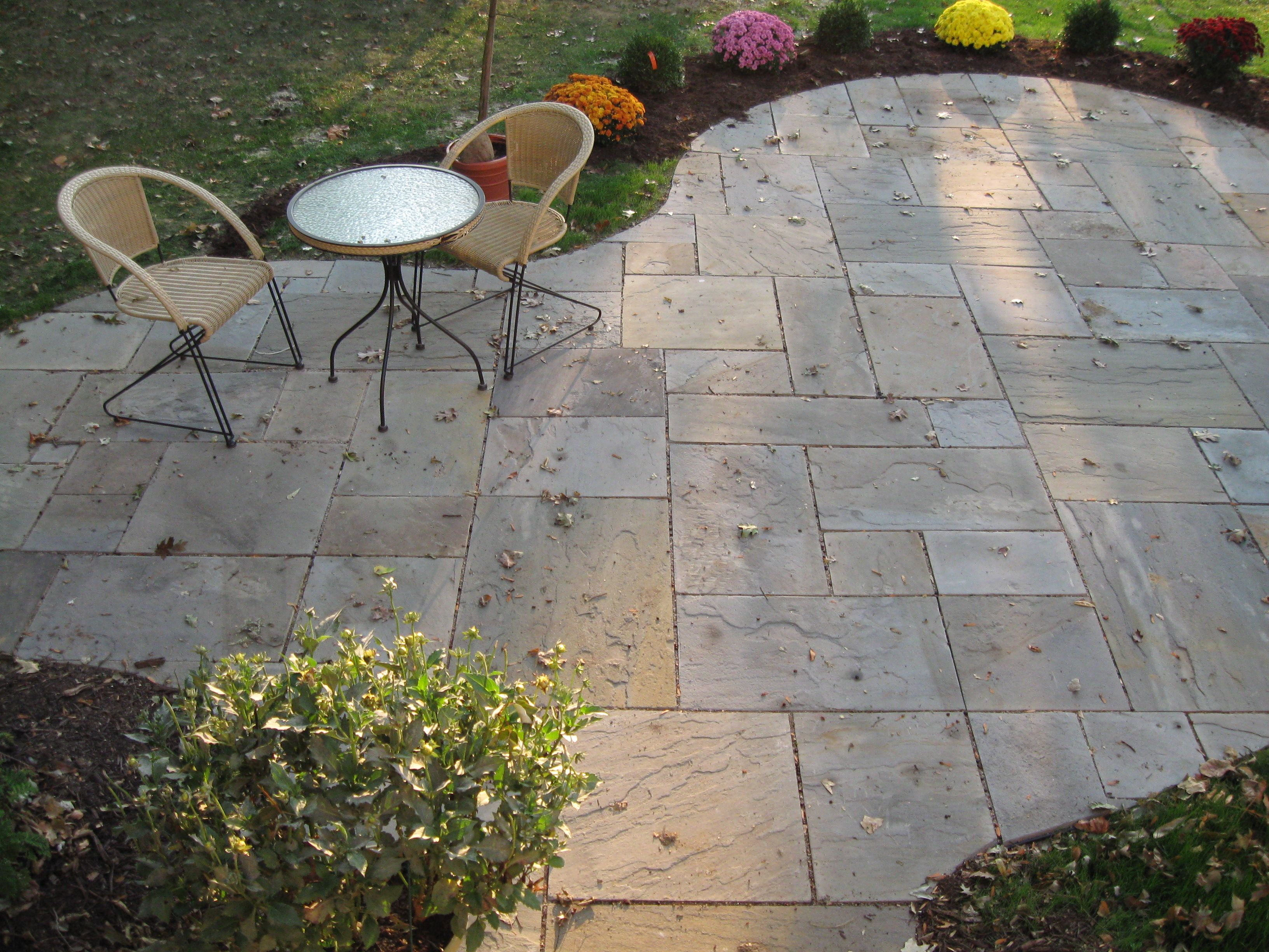 curving blue stone patio 300 sqft installed by techmer nursery