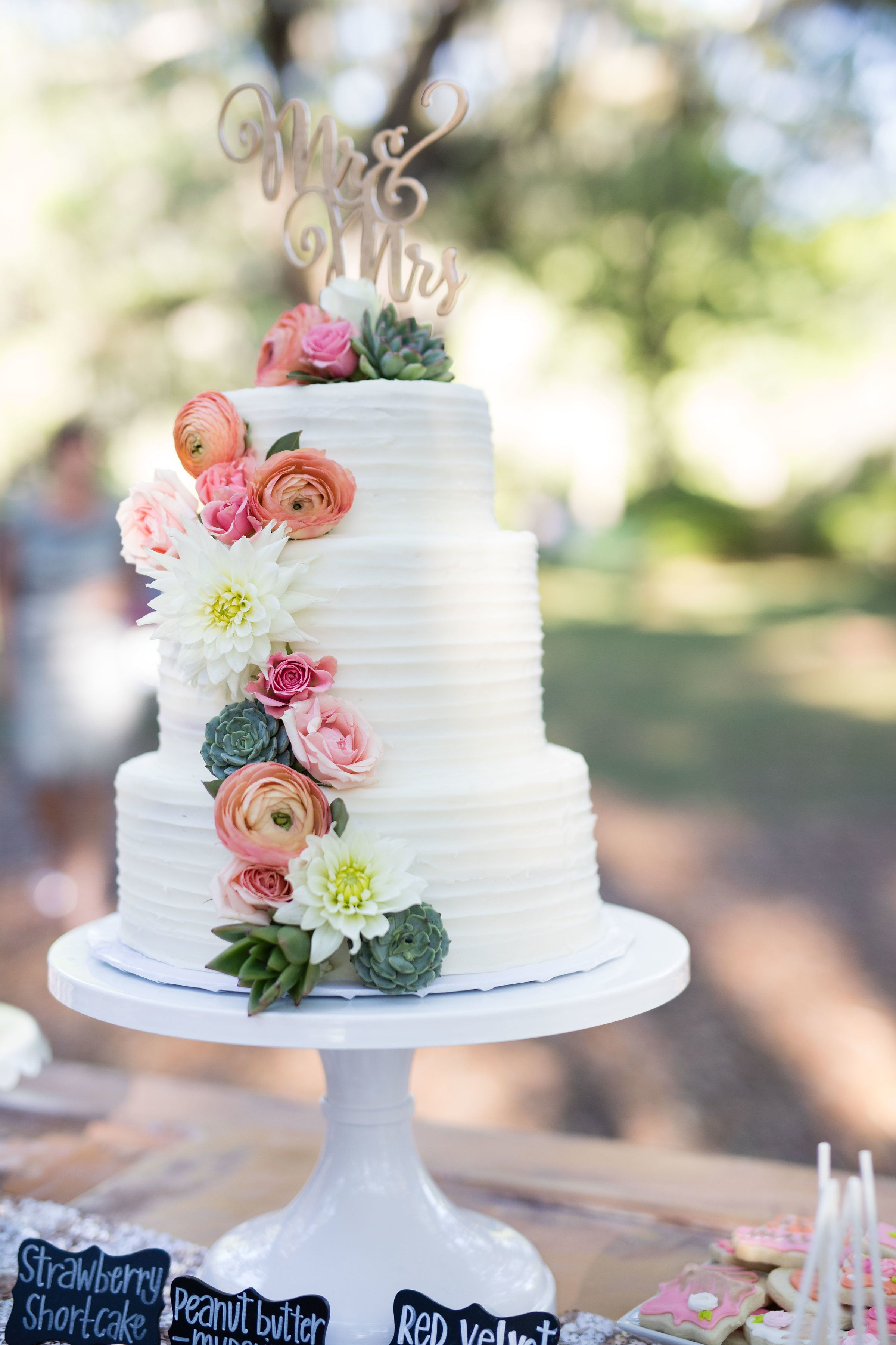 Rustic 3 Tier Wedding Cake With Fresh Flowers And Succulents With