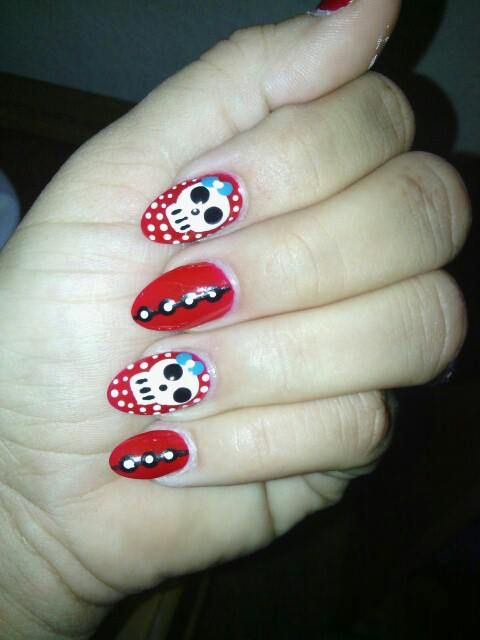 awesome red nails with skulls.....rebel!