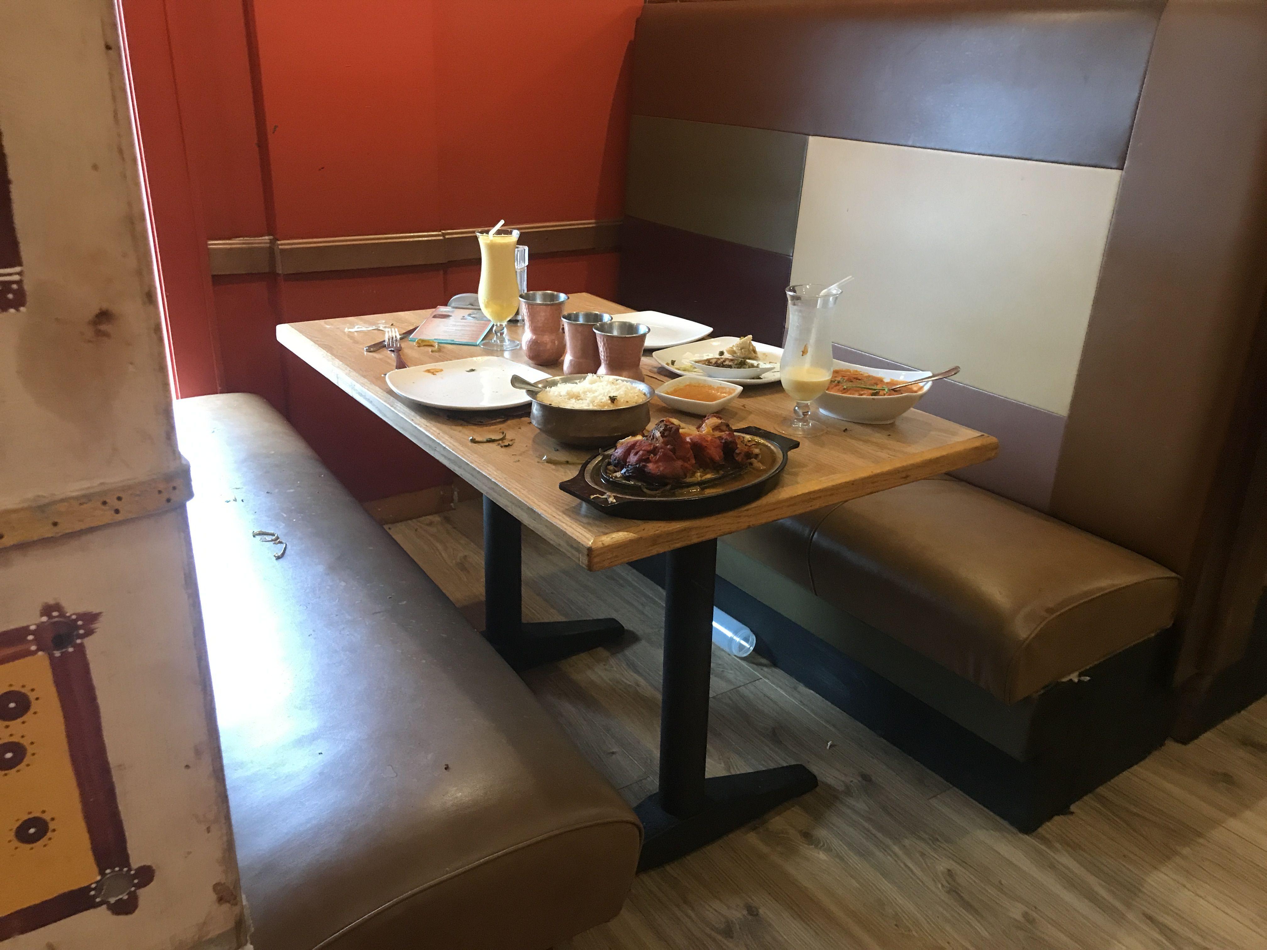 Indian restaurants interior design customer server burned during cooking demo at indian restaurant