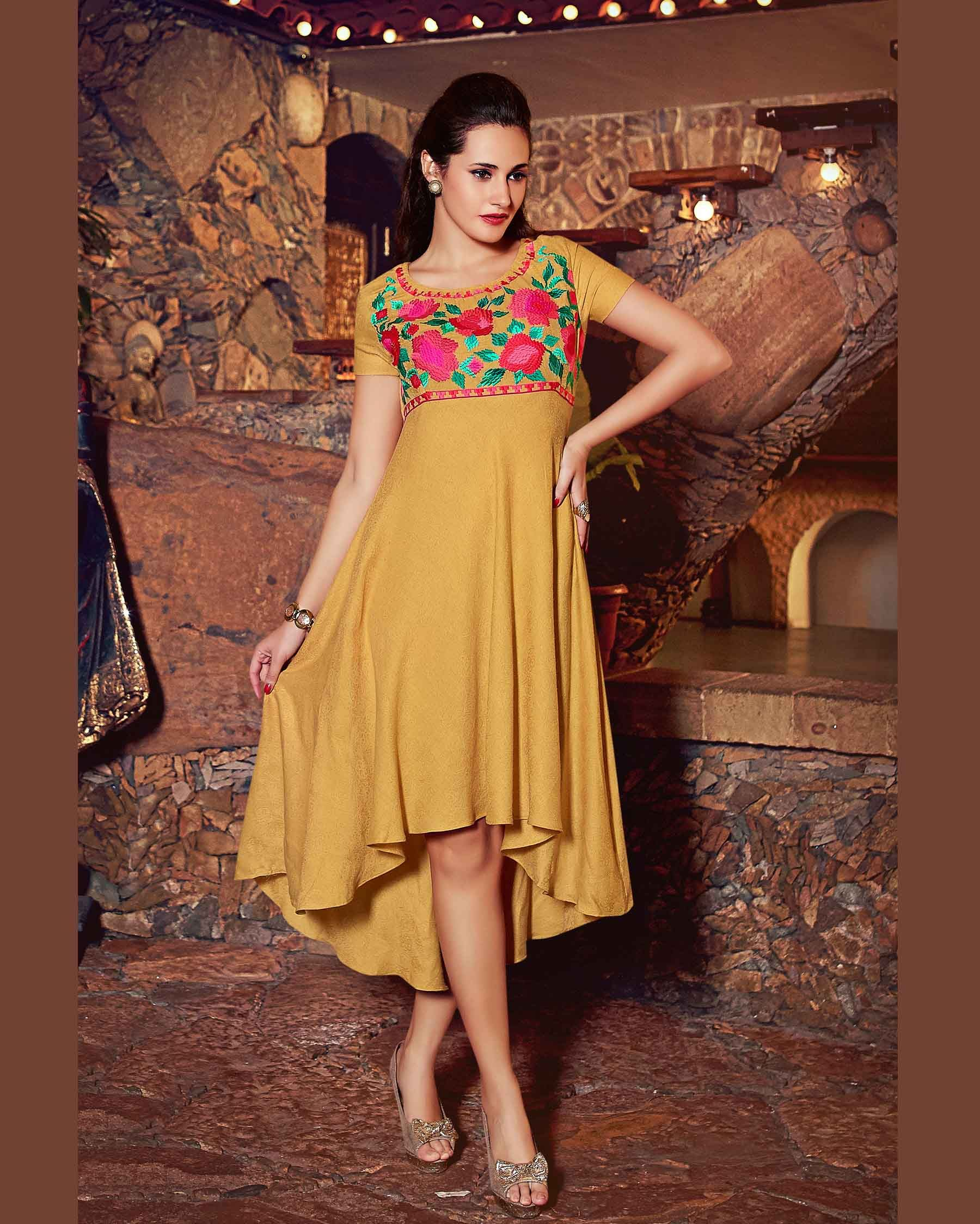Beige   lush Embroidered Pure Linen Tunic kurtis       Fabric:   Pure Linen       Work:   Embroidered       Type:   Tunic kurtis       Color:   Beige