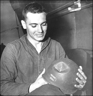What better reason to smile? A nearly-spent artillery fragment failed to penetrate this soldier's helmet. Infantrymen most dreaded being shelled in a heavily wooded forest; incoming artillery rounds exploded on contact with the tree tops, driving shrapnel into their fox holes and shelters.