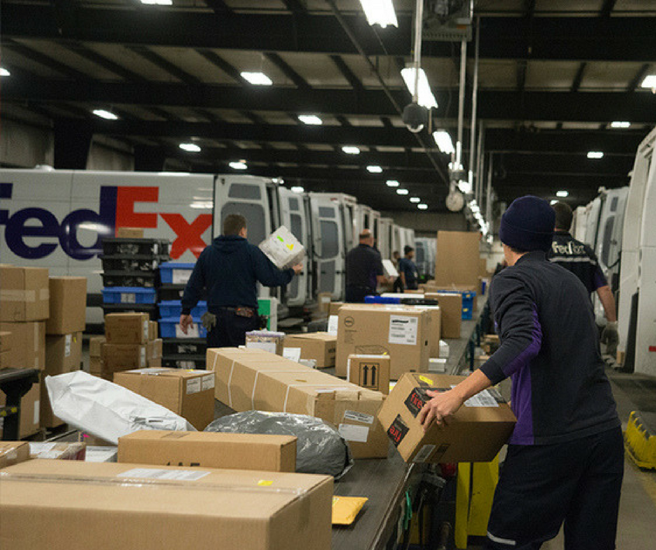 Sorting parcels to be loaded on to delivery vehicles at the FedEx ...