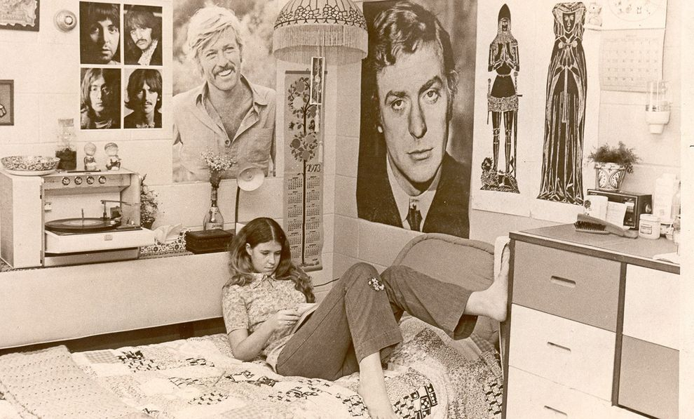A student at the University of South Florida, studies in her dorm while under the watchful gaze of Michael Caine, Robert Redford (showing off quite a bit of heavage), and the Beatles.