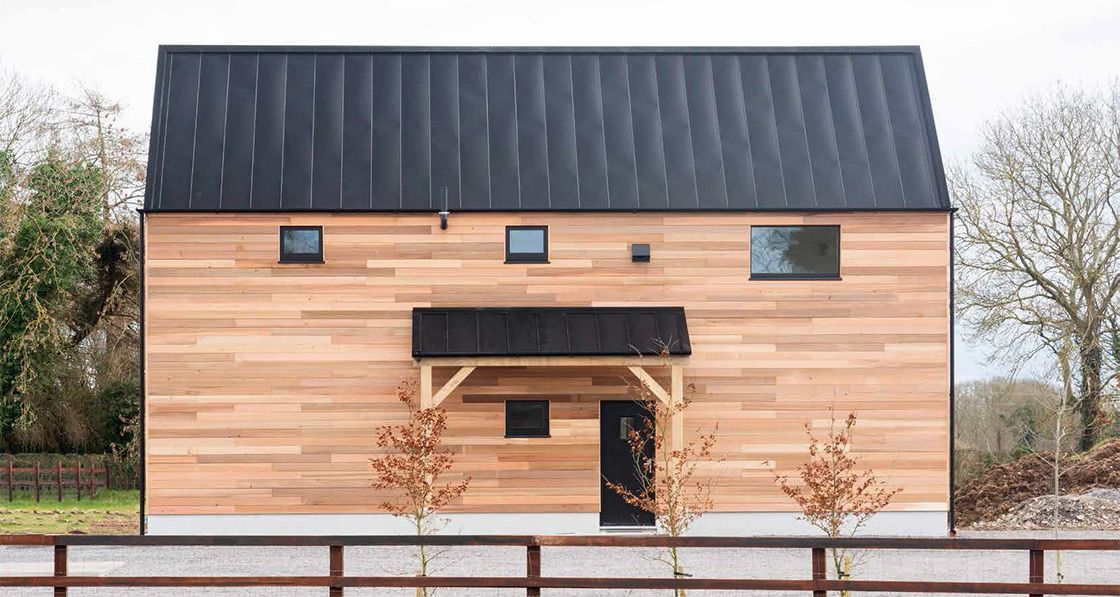 This Brand New Light Filled Passive House Set In The Countryside Of North Kildare Was Inspired By Local Farm Farm Buildings Building Design Architecture House