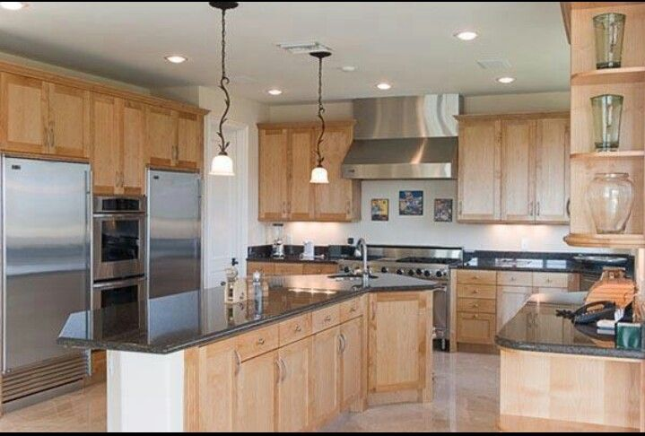 Definitely not your typical oak cabinet kitchen. I like ...