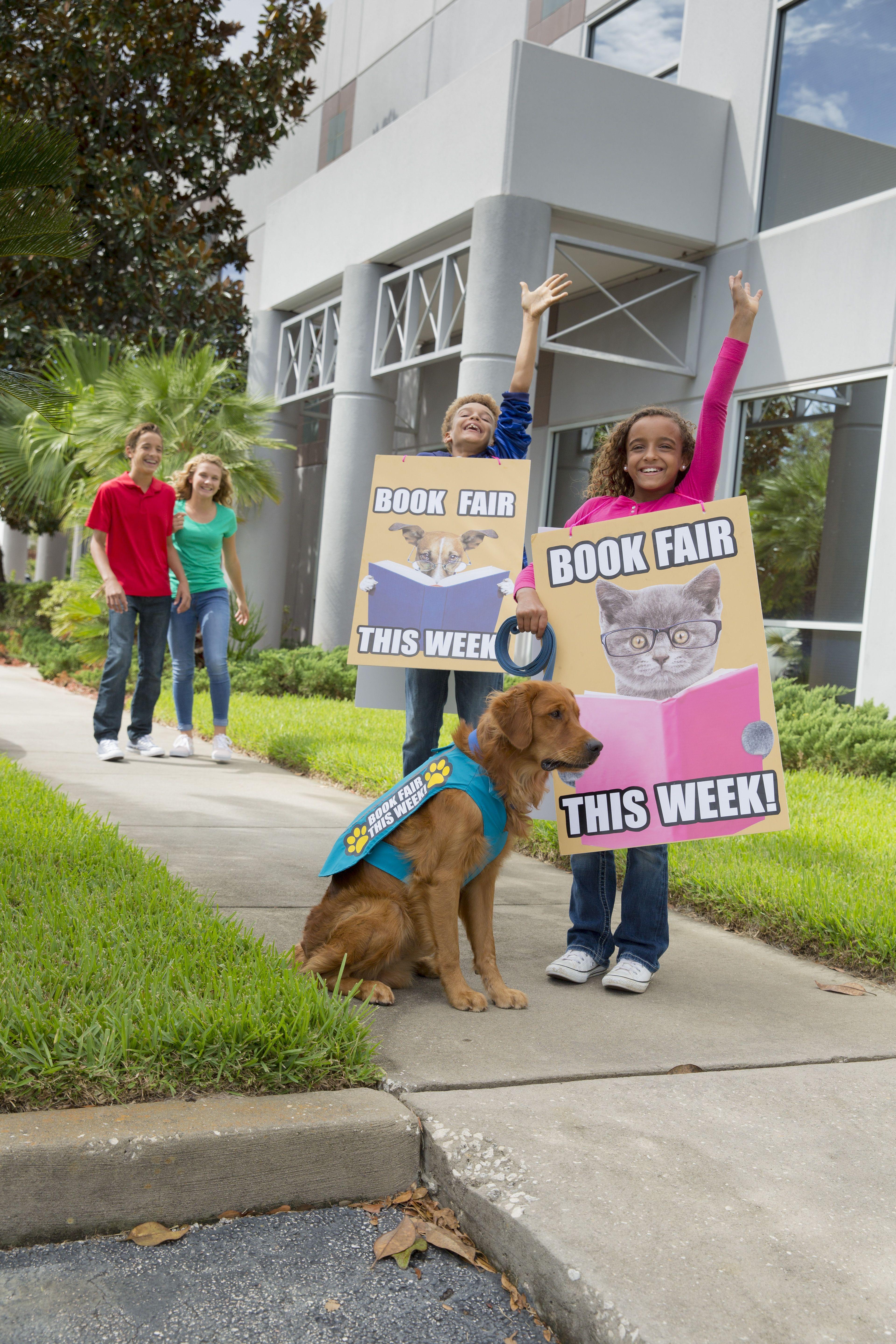 Outfit Student Volunteers With Sandwich Board Signs And A Dog With
