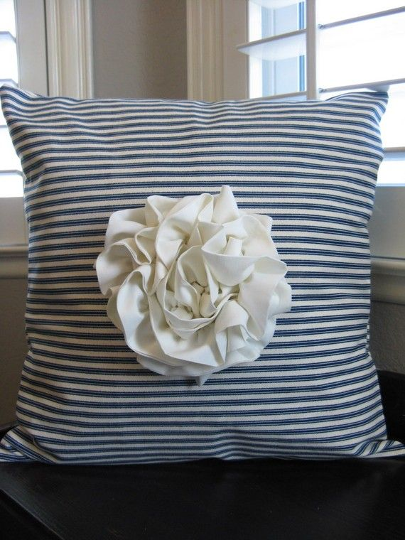 Ticking stripe pillow with large rosette