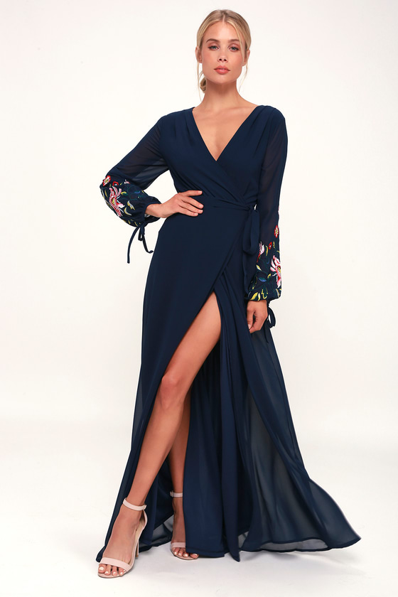 801331e7a Turn heads in the Lulus My Angel Navy Blue Embroidered Long Sleeve Wrap  Maxi Dress! Lightweight woven poly shapes a plunging surplice neckline, ...