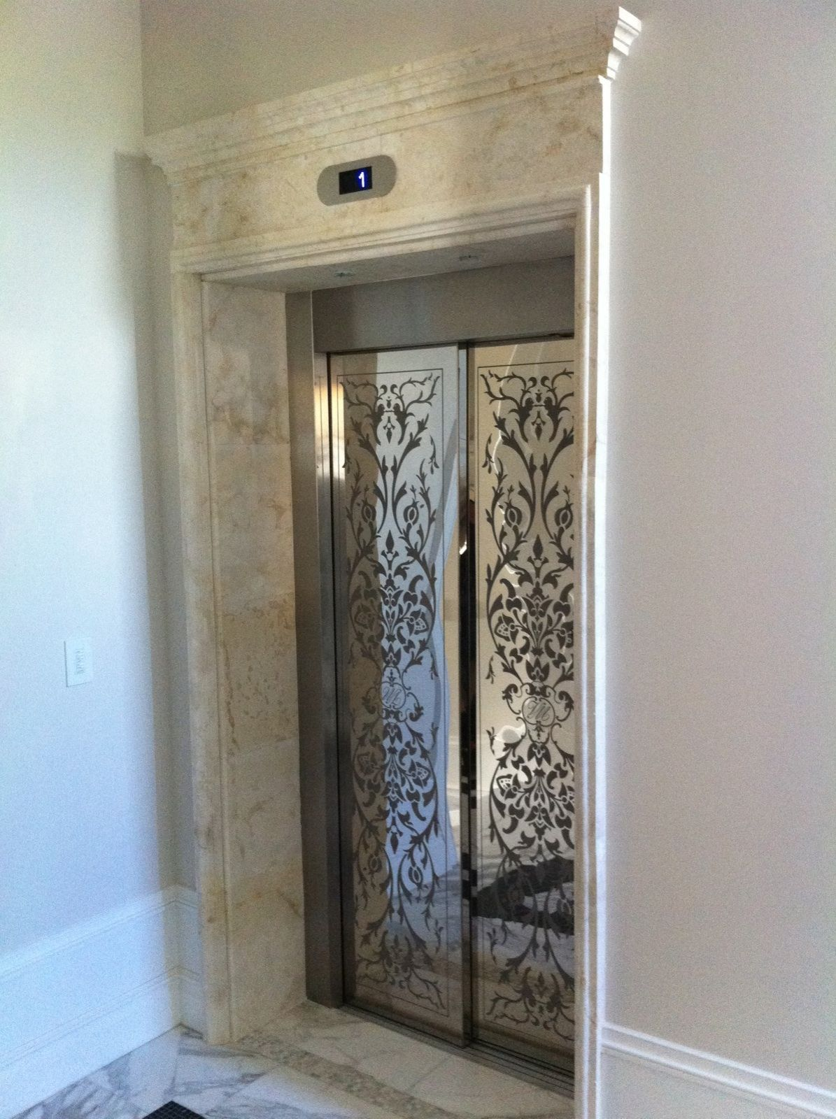 Elevator Doors & Trim. Wouldn't this be a statement in your home!! Beautifully done.