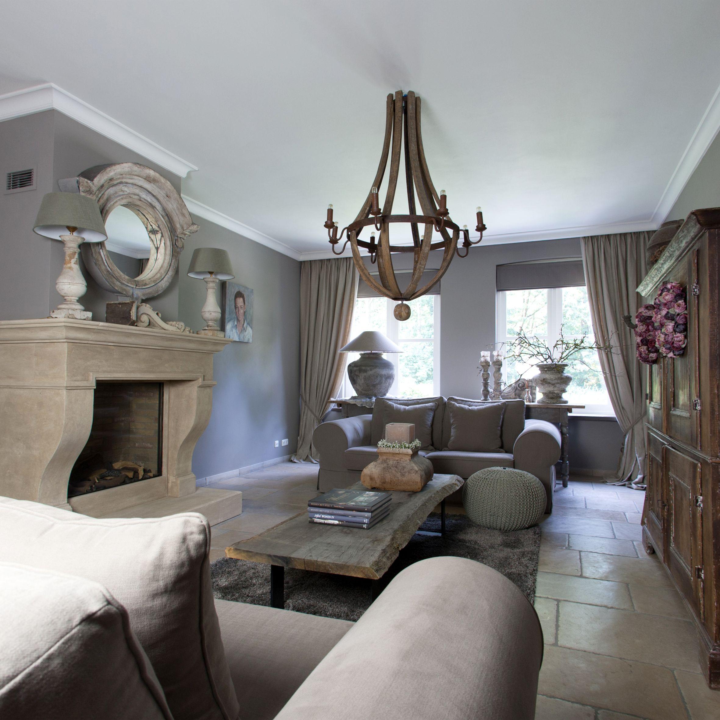 belgium gray walls, stone floors, light fixture