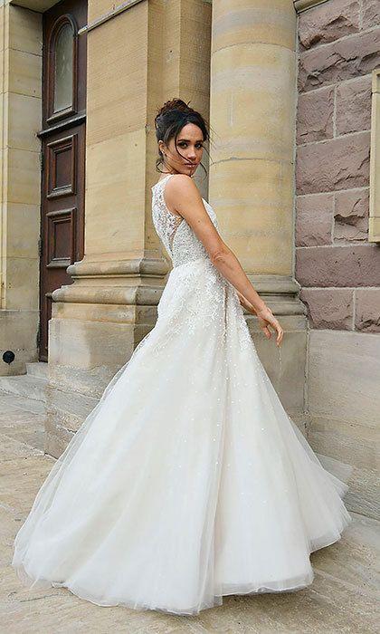 Megan Markle In Her Character Of Rachel Zane Wearing A Wedding Dress