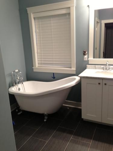 Norman Faux Wood Blinds Give Clic Beauty To This Homeowner S Serene Bathroom With Carrera Marble