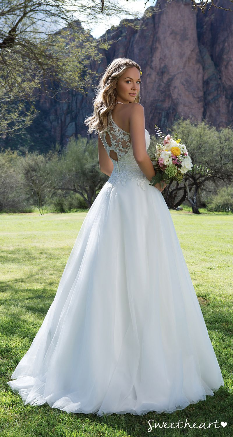 Style 1126: Be flirty in this beaded lace illusion halter wedding ...