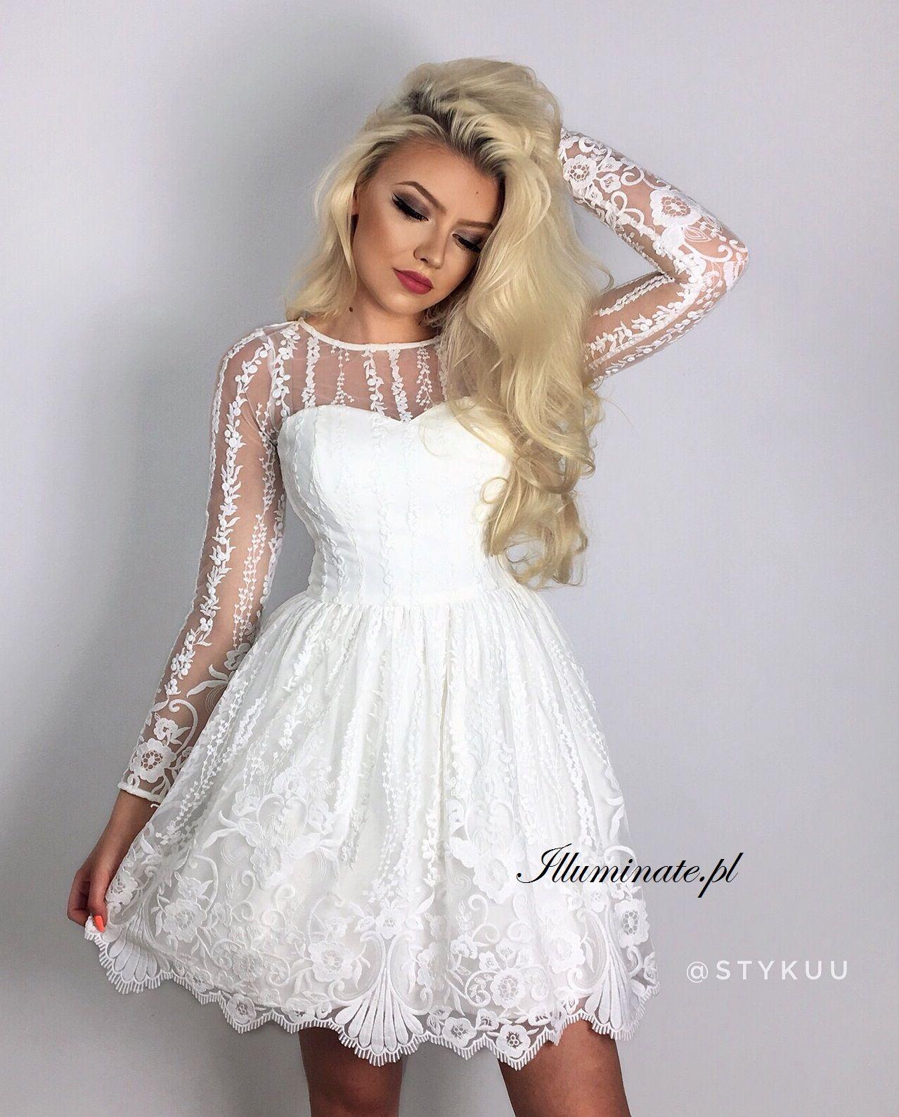 de274867886 Allison Rozkloszowana biała sukienka z długim rękawem, wykonana z kilku  warstw tiulu. Sukienka uszyta jest z pięknej gipiury z delikatnym kwiatowym  motywem