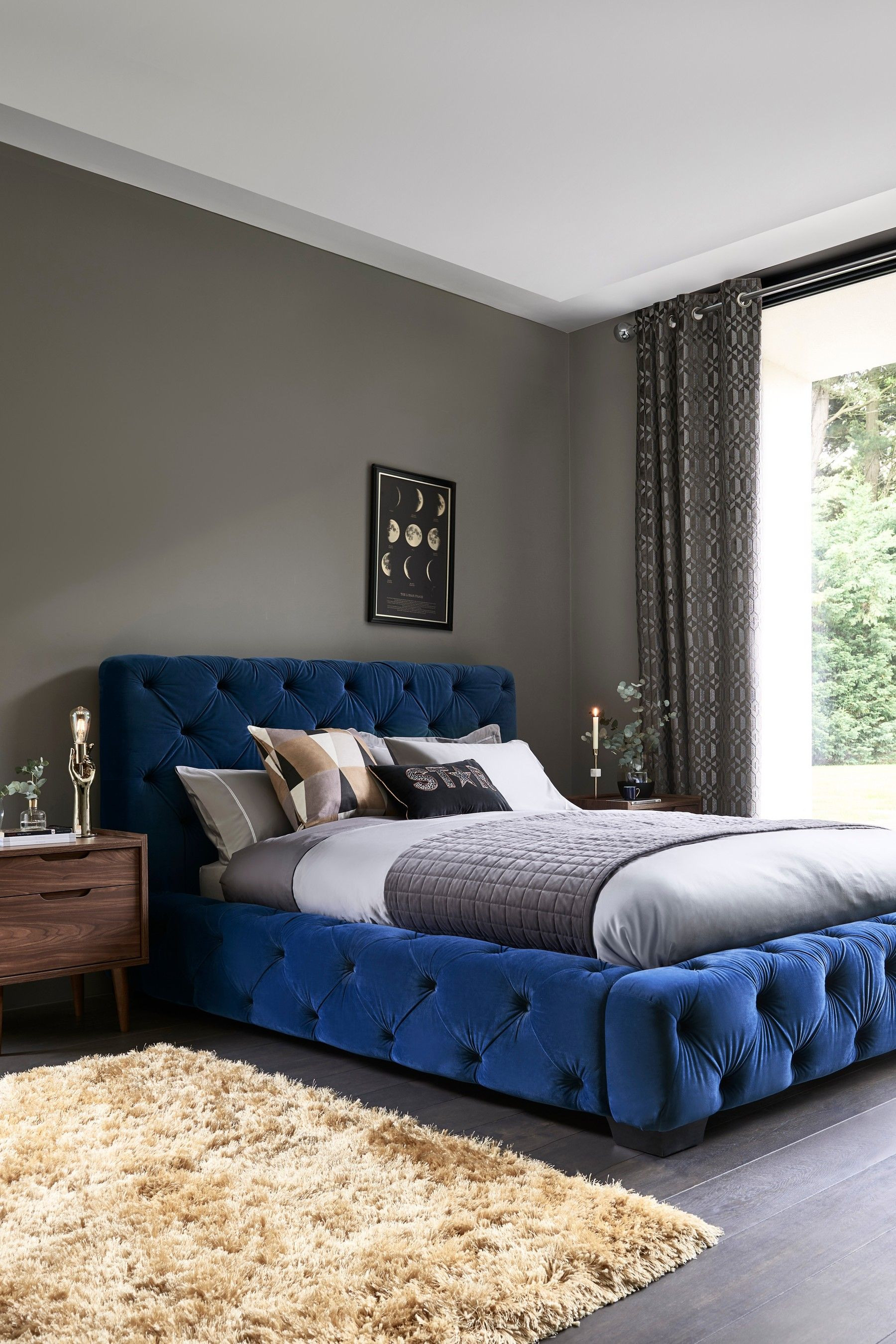 This buttoned bed from Next looks so luxurious bed blue