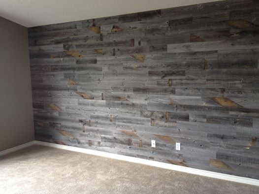 Reclaimed weathered wood fireplace wall master bedroom How to cover old wood paneling