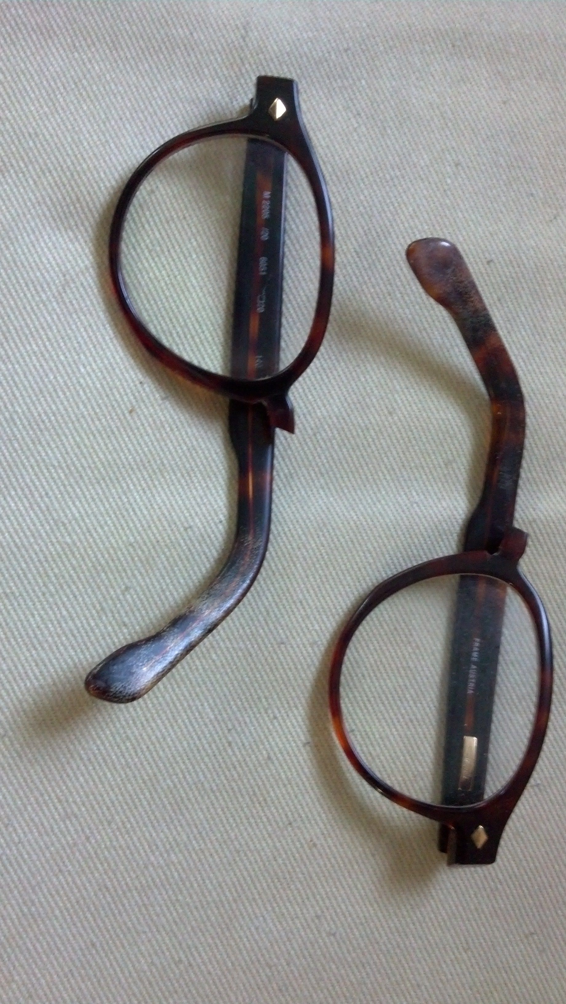 Before photo of plastic tortoise eyeglass frames with