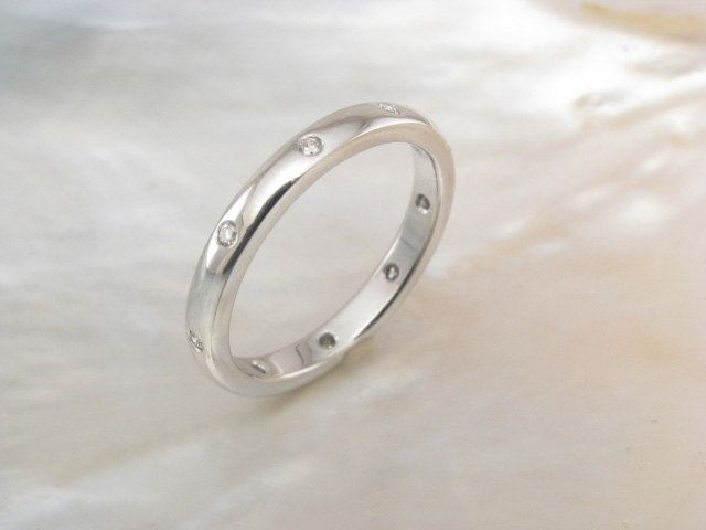 handmade platinum wedding ring with scattered flush set diamonds