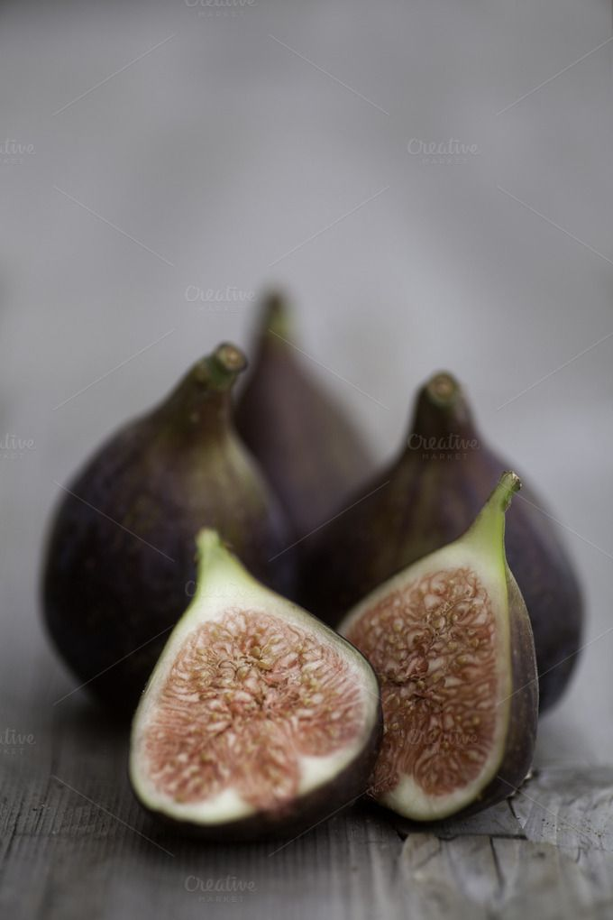 Check out Figs on a Rustic Wooden Table by More Than Cake on Creative Market