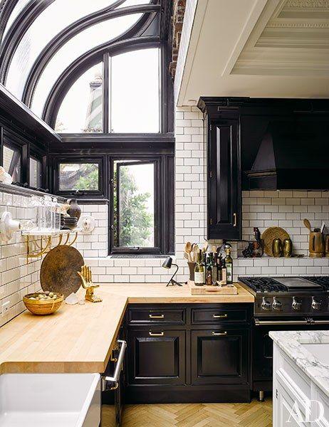 Solarium Kitchen | Butcher Block Countertops | Black Lacquer Kitchen Cabinets | Subway Tile Dark Grout Kitchen | New York City Loft Kitchen | Herringbone Wood Floor Kitchen | Nate Berkus