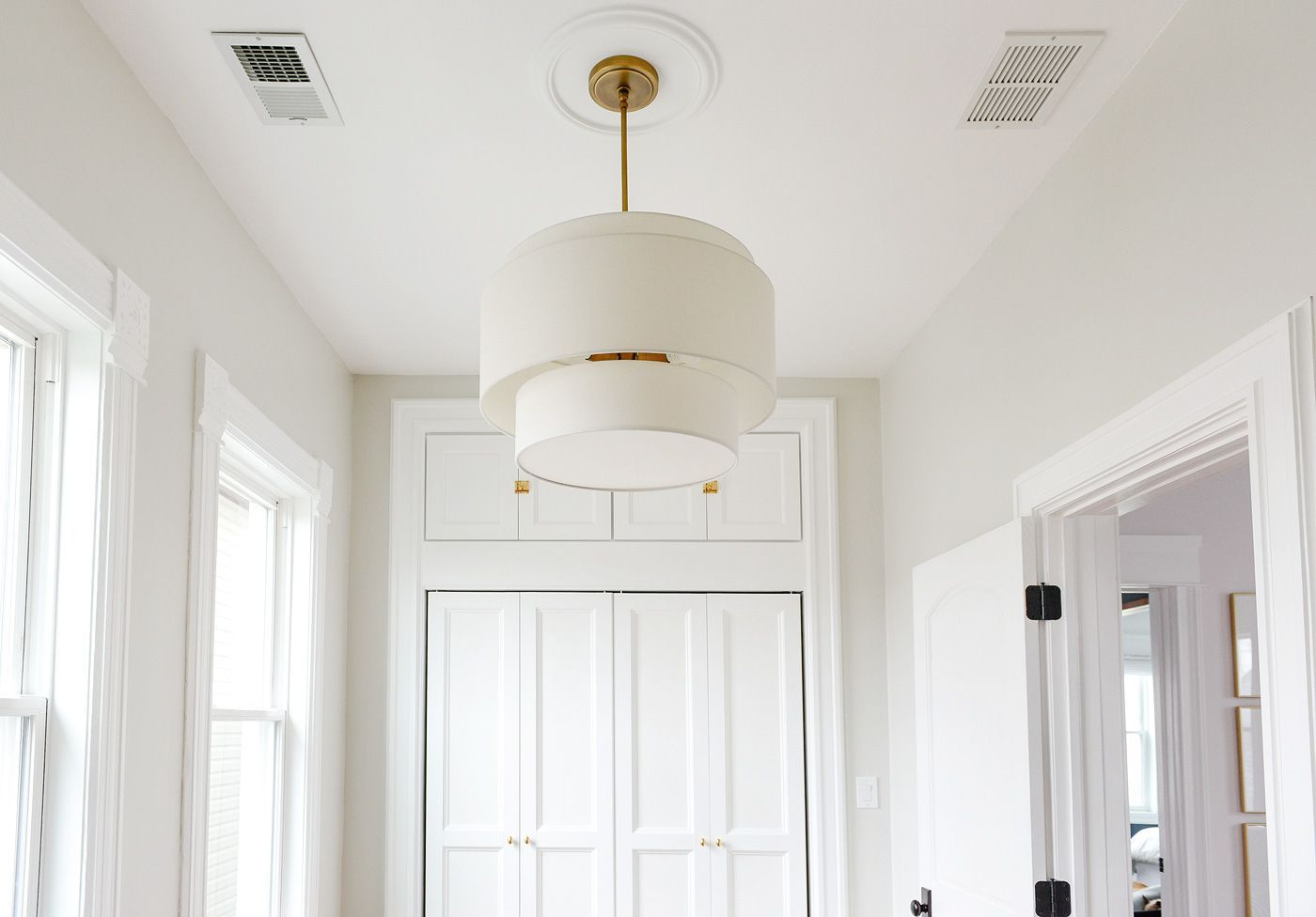 The scary room gets brass hardware and a tiered linen pendant light the scary room gets brass hardware and a tiered linen pendant light from rejuvenation mozeypictures Gallery