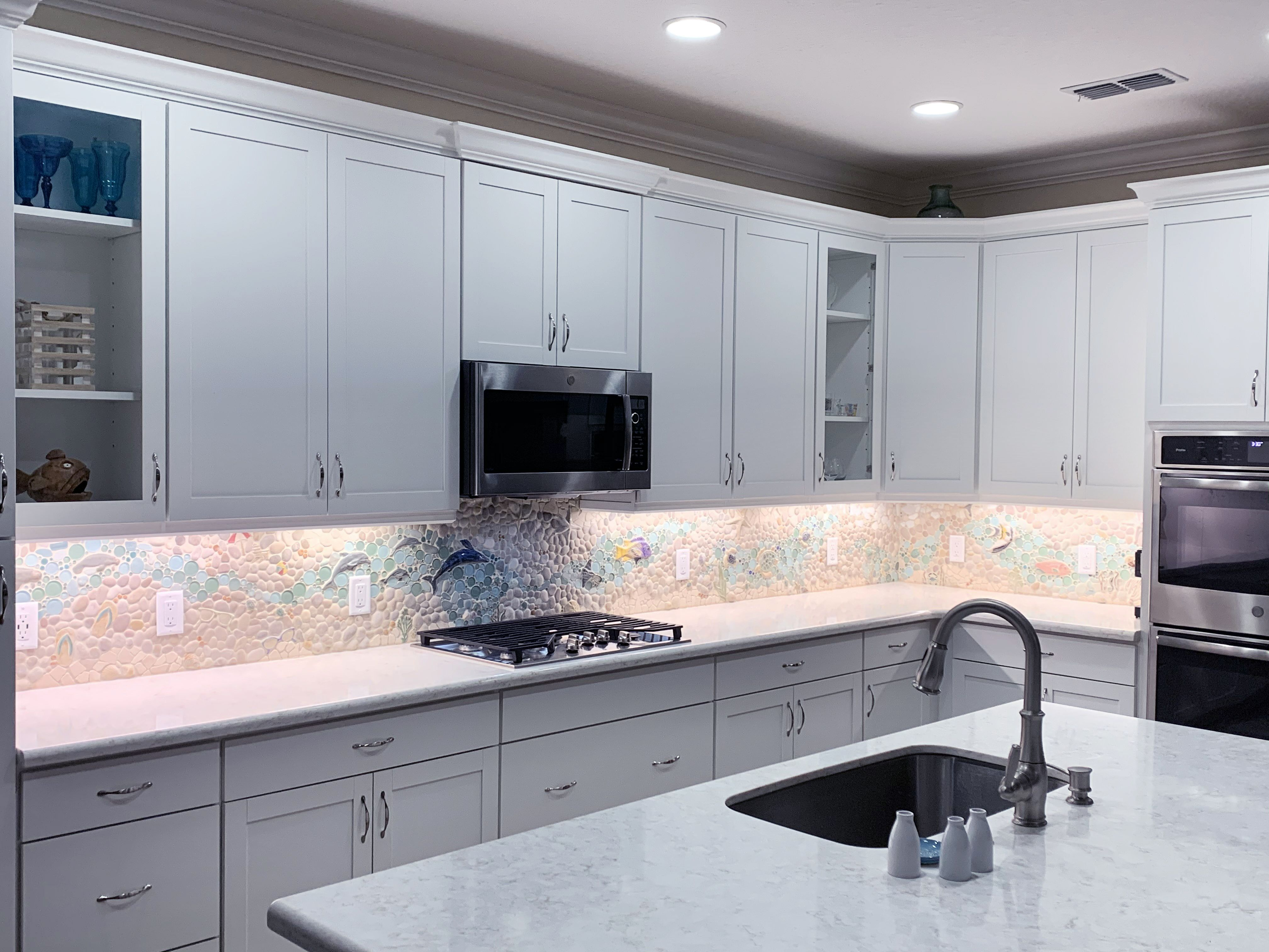 This Custom Nautical Mosaic Kitchen Backsplash Was Made With Our Medley Of Round Glass Na In 2020 With Images Mosaic Backsplash Kitchen Kitchen Installation Unique Tile