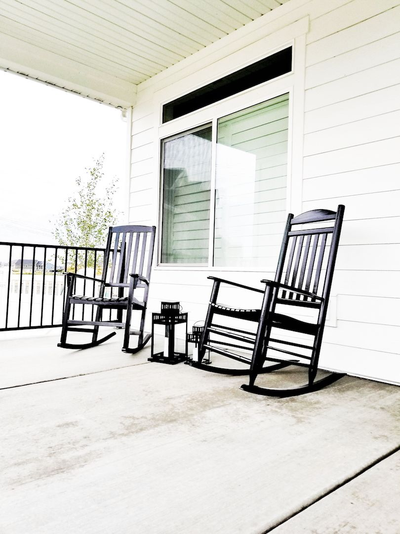 All White Houses #whitelanedecor @whitelanedecor Front porch, all white house, black and white  house, black rocking chairs on white house, farmhouse garage lights, ...