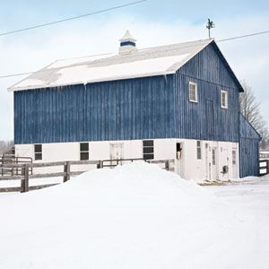This is the first blue and white barn I've ever seen!!! Country Living magazine: owner stained the barn blue to remind her of Europe.......This is Dragonfly Farm in Canada (Country Living)