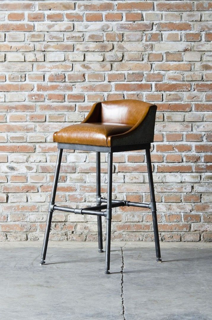 BAR STOOL WITH UPHOLSTERED LEATHER LOW CAMEL BACK SEAT OVER INDUSTRIAL PIPE  LEGS AND H STRETCHER