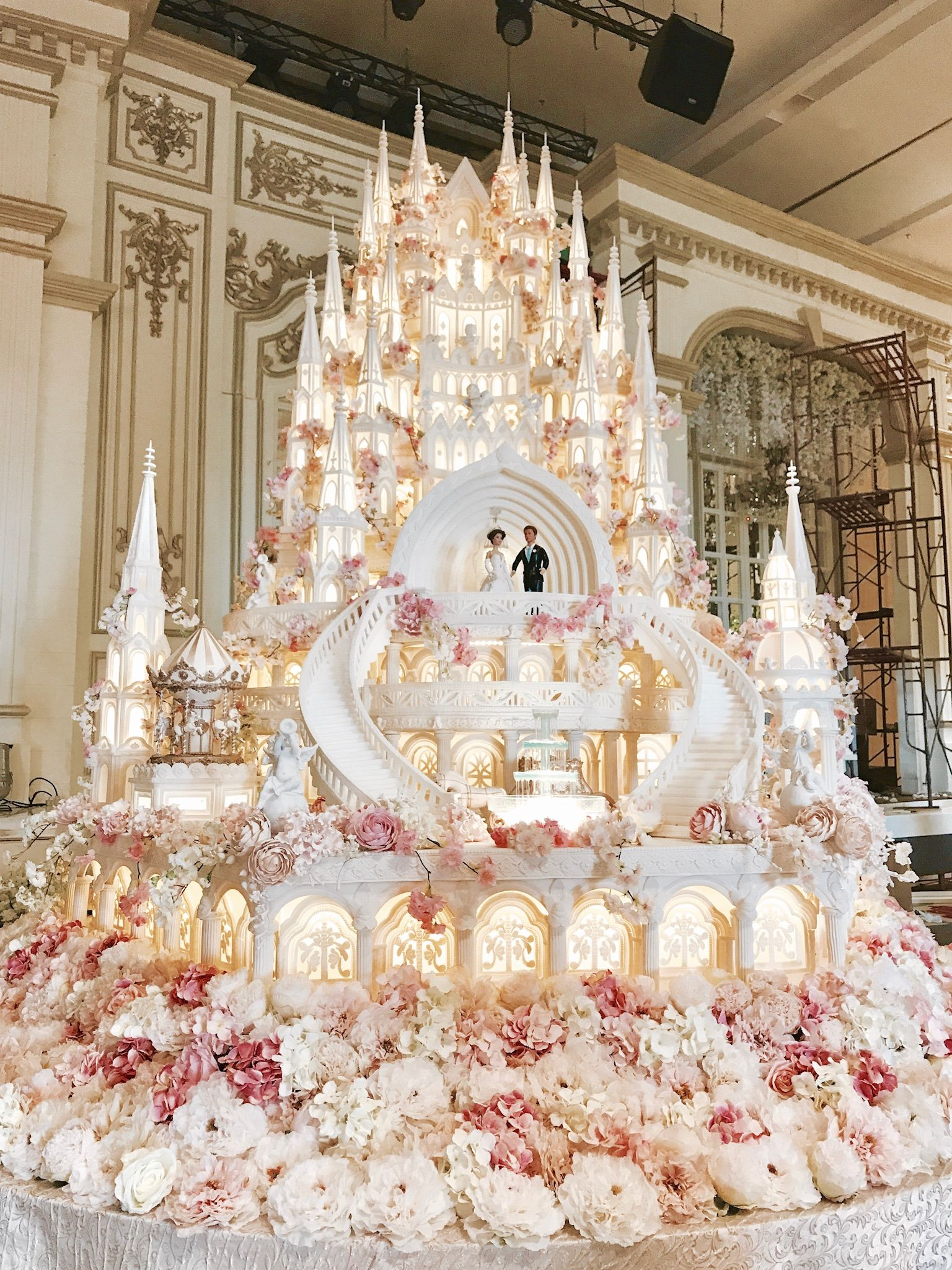 Elegant white and beige floral wedding cake Victorian