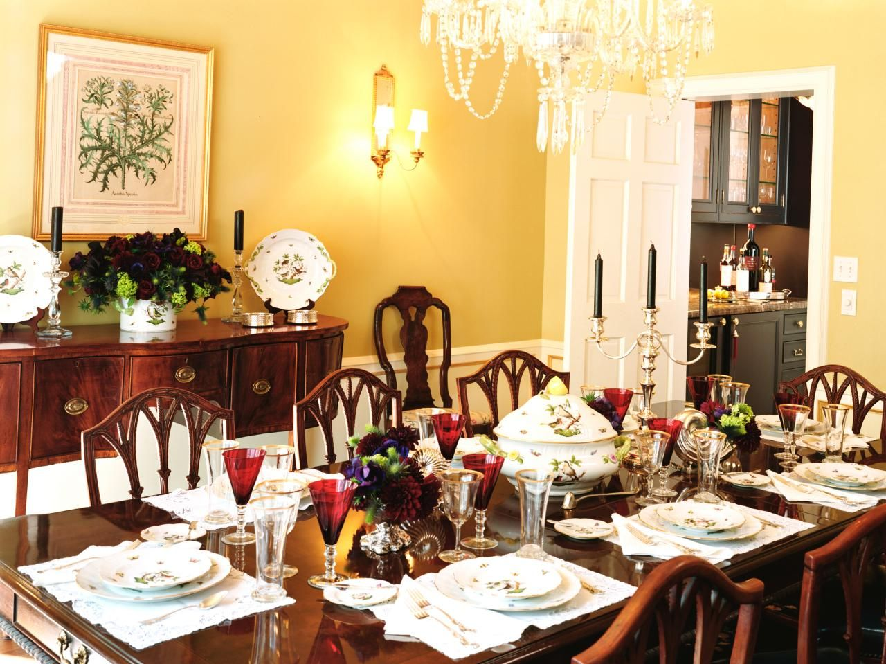 This formal dining room has yellow walls and is anchored by an ...