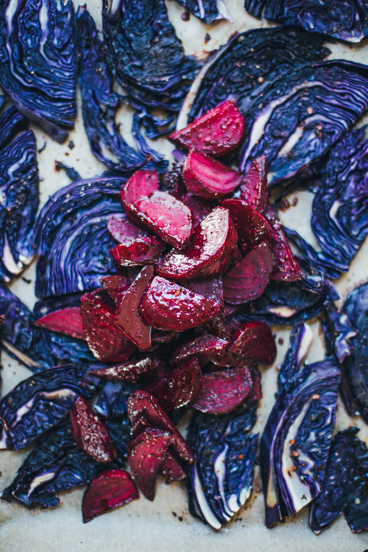 Get the recipe for this warm, roasted red cabbage and beet salad tossed with salty tamari, tangy lime, chickpeas, macadamia nuts and sunflower seed butter.