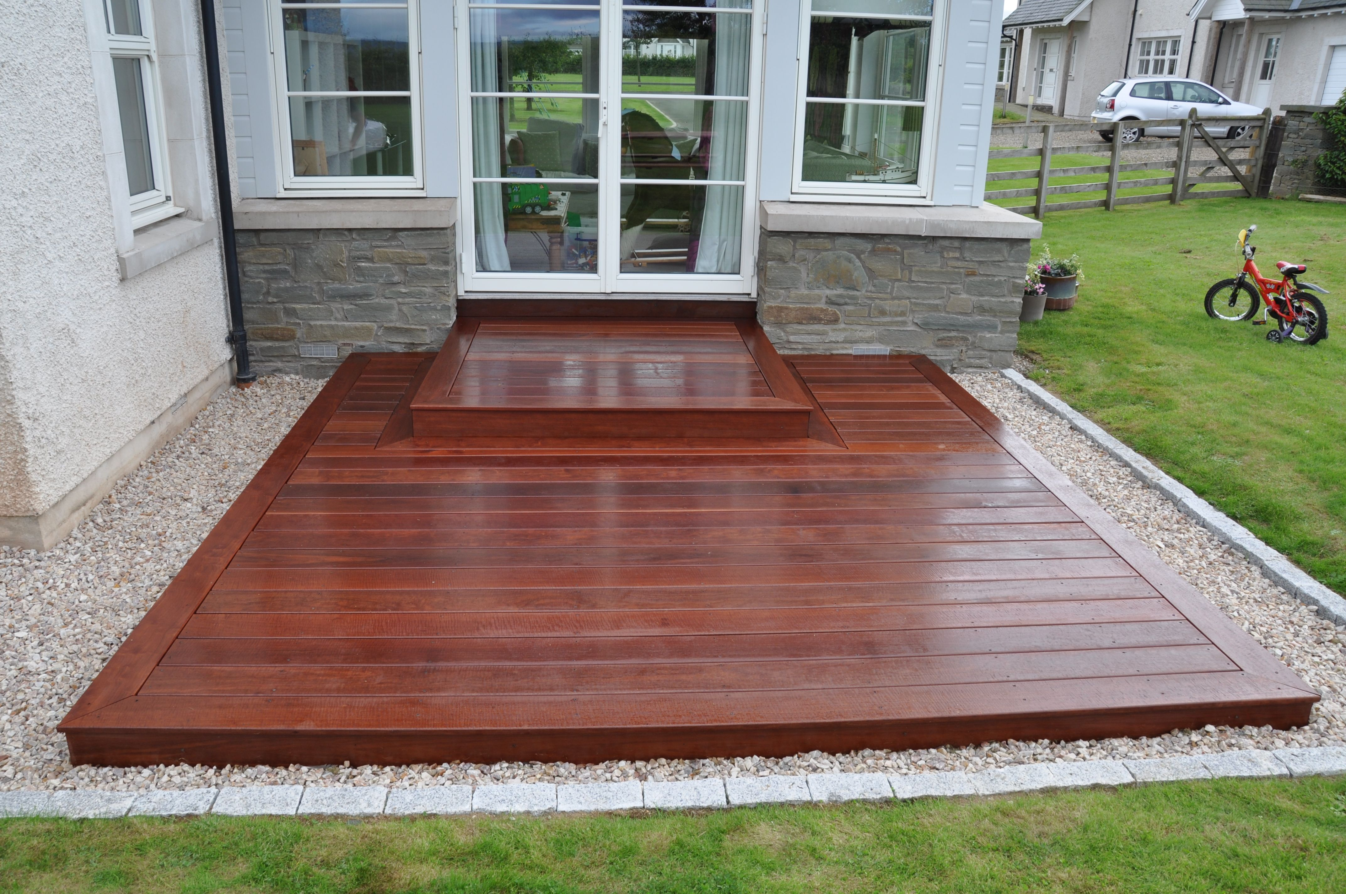 A Simple Square Deck Provides Practical Entrance And An