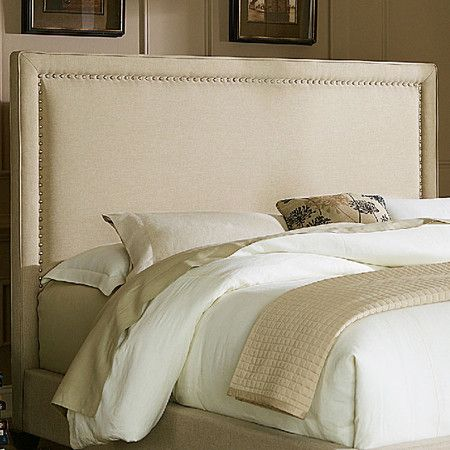 Showcasing nailhead-trimmed linen upholstery, this lovely headboard brings a touch of elegance to your master suite.  Product: H...