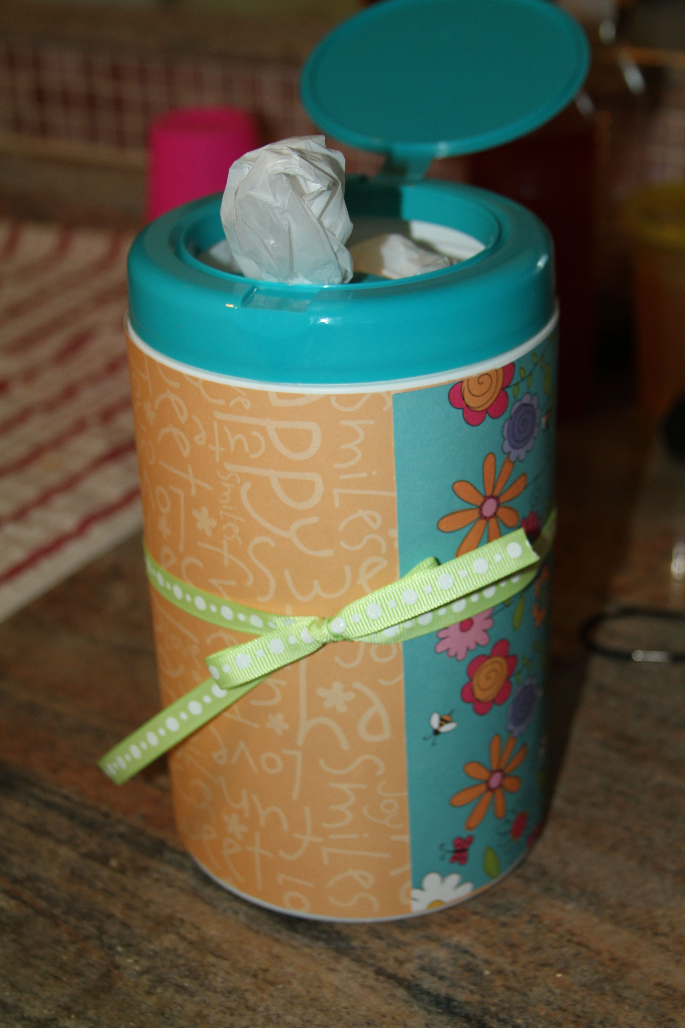 Recycle lysol wipe container to hold plastic grocery bags. I love this idea. You could use empty baby wipes containers too!