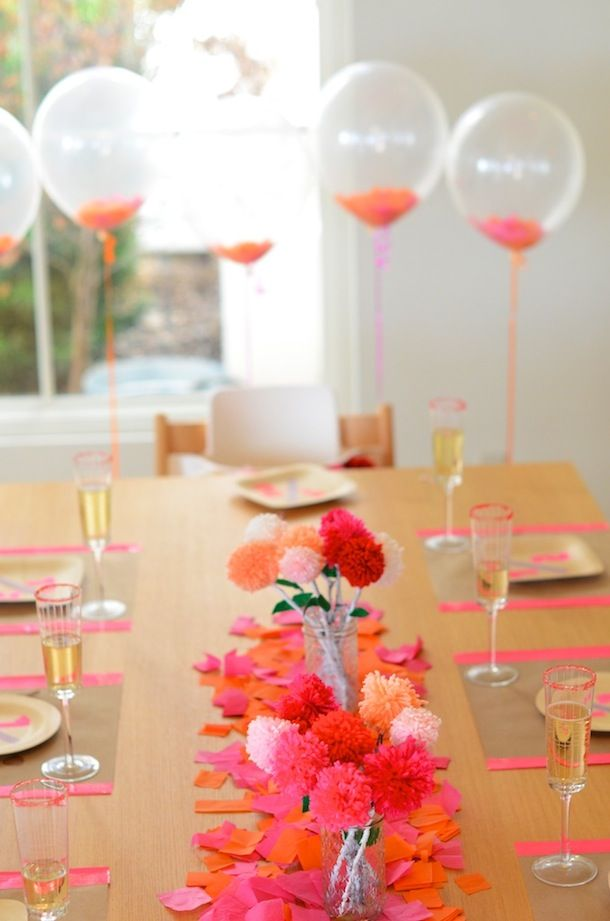 Neon Pink Orange Tablescape With Yarn Pom Flowers And Clear Balloons Confetti