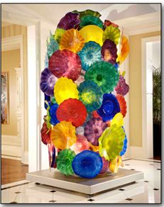 Chihuly- coffe filters attached to form--filters would have to be brushed with modge podge and draped onto something then glue to a cardboard cylinder of sorts