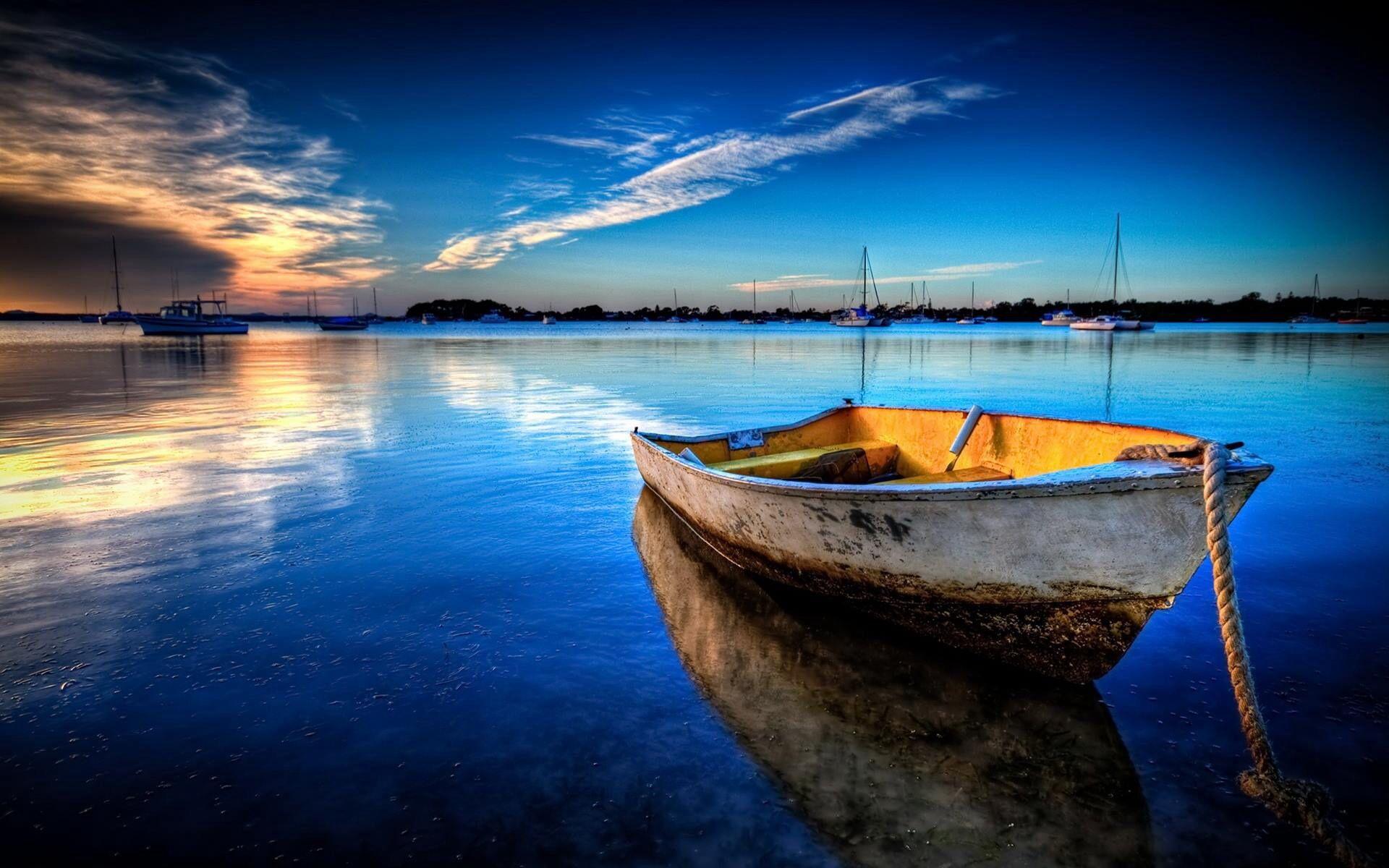 Serene And Peaceful Ocean Landscape Sunset Wallpaper Boat