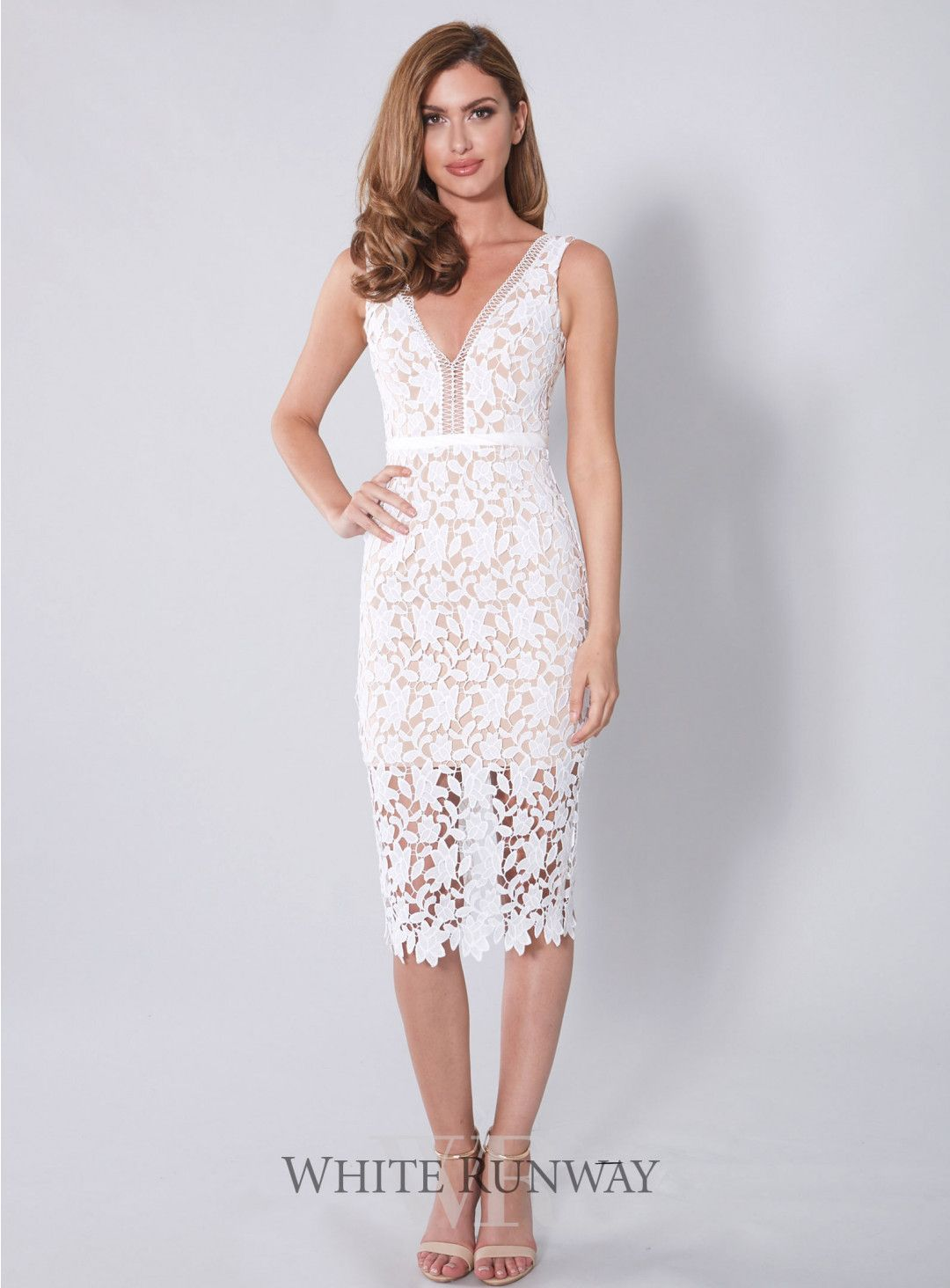 Cocktail length lace overlay dress